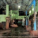 The selling point of meat processed in the slaughter house kept on the floor where the customers use to walk.